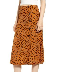 ALL IN FAVOR Animal Print Button Midi Skirt